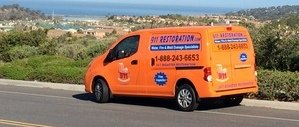 Mold Removal and Water Damage Restoration Van Driving To Job Location