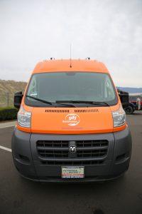 911-restoration-water-damage-mold-remediation-fire-damage-person-van-front-